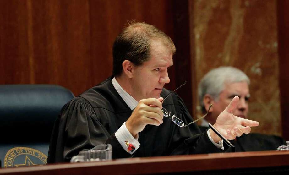 Texas Supreme Court Justice Don Willett, who has been nominated to be United States Circuit Judge For The Fifth Circuit, successfully performed the Heimlich maneuver on a fellow dad at an Austin Chick-fil-A on Tuesday, Nov. 28, 2017. (AP Photo/Carolyn Kaster) Photo: Eric Gay, STF / Copyright 2016 The Associated Press. All rights reserved. This material may not be published, broadcast, rewritten or redistribu