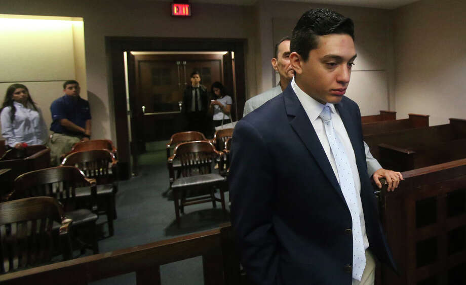 Defendant Antonio Flores,22, prepares to leave court Wednesday May 18, 2016 during his manslaughter trial in the 226th District Court. Flores is accused in the case of a car crash in which two high school girls died in 2013 during an alleged car race. Photo: John Davenport, Staff / San Antonio Express-News / ©San Antonio Express-News/John Davenport