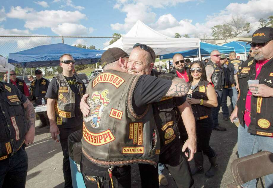 Jeff Pike, former Bandidos Motorcycle Club president, center-right, is greeted by members at the group's 50th anniversary party on March 12 in Kingwood. Photo: Jon Shapley, Staff / © 2015  Houston Chronicle