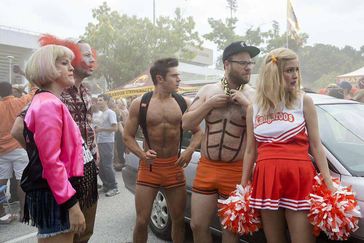 """This image released by Universal Pictures shows, from left, Carla Gallo, Ike Barinholtz, Zac Efron, Seth Rogen and Rose Byrne in a scene from """"Neighbors 2: Sorority Rising,"""" premiering in the U.S. on May 20. (Chuck Zlotnick/Universal Pictures via AP)"""