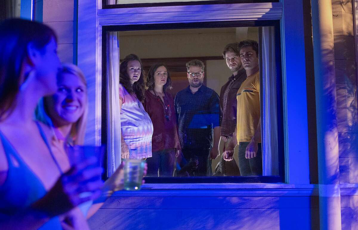 """This image released by Universal Pictures shows, background from left, Carla Gallo, Rose Byrne, Seth Rogen, Ike Barinholtz and Zac Efron in a scene from """"Neighbors 2: Sorority Rising,"""" premiering in the U.S. on May 20. (Chuck Zlotnick/Universal Pictures via AP)"""