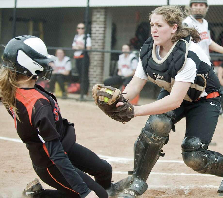 Stamford High School's Kyra Yacavone slides into home as Ridgefield High School catcher Gwen Ellis puts the tag on in a game played at Ridgefield. Wednesday, May 18, 2016 Photo: Scott Mullin / For The / The News-Times Freelance