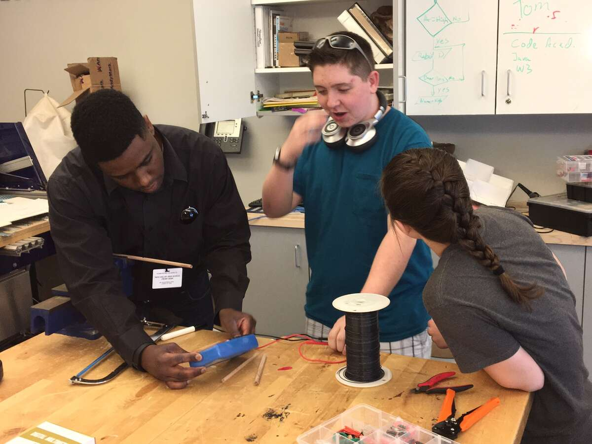 Matthew Fowles, left, an engineer for National Grid, helps Tech Valley High School students make electrical circuits on Wednesday May 18, 2016.