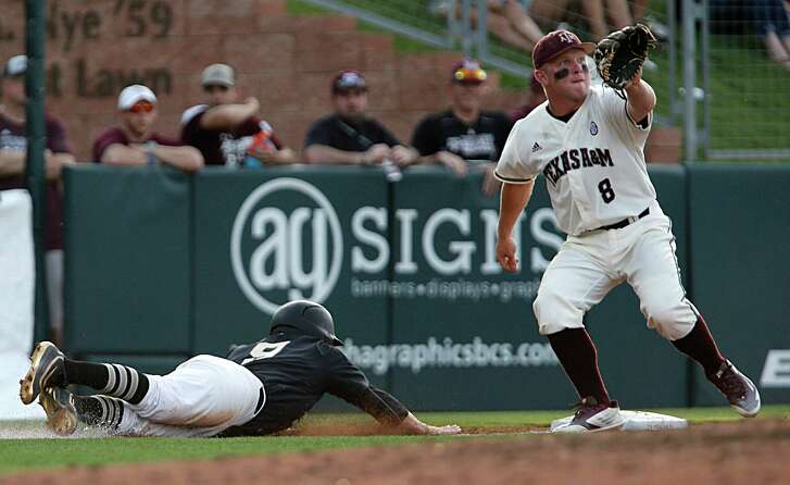 Vanderbilt infielder Will Toffey (left) dives past Texas A&M's Boomer White rto slide safely back to third base during the fourth inning at Blue Bell Park on May 5, 2016, in College Station.