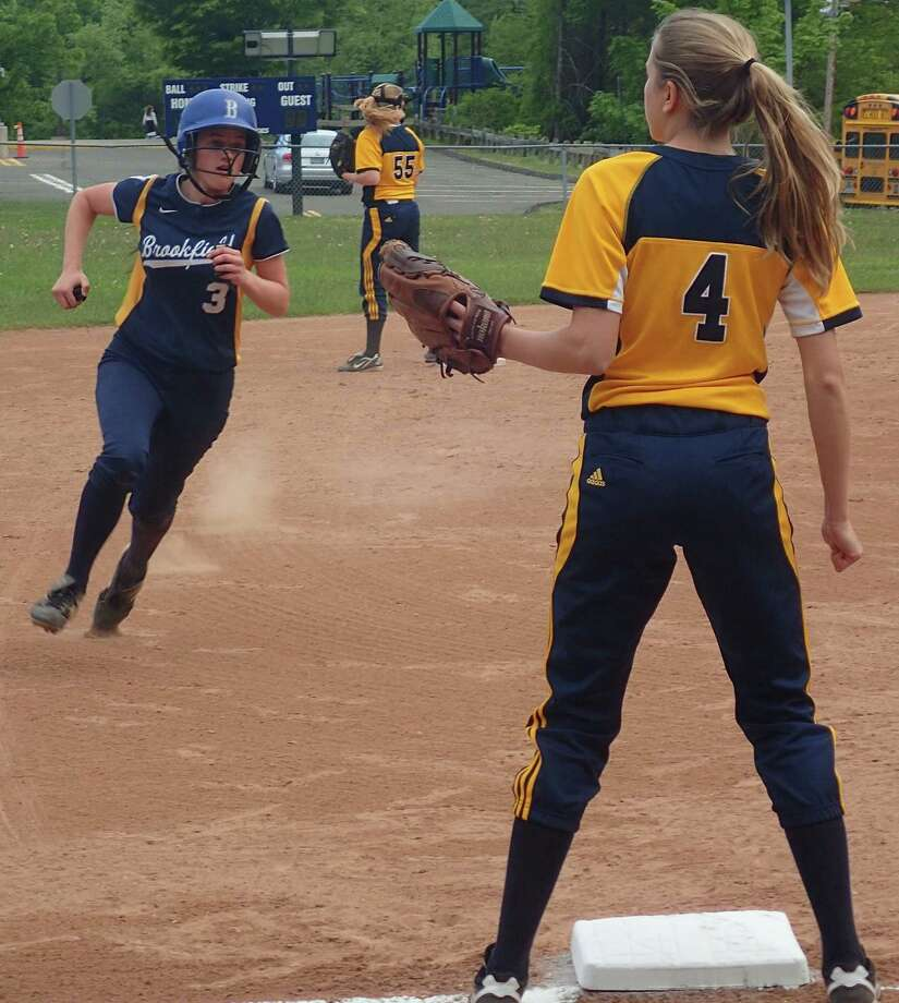 Brookfield's Cara Lennon, left, rounds third and heads for home to score the game's lone run in the Bobcats' 1-0 win over Weston. Weston third baseman Mallory Rogers awaits the throw. May 18, 2016 at Weston. Photo: Richard Gregory / Richard Gregory