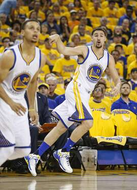 Golden State Warriors� Klay Thompson watches his first three pointer in the first quarter during Game 2 of the NBA Western Conference Finals at Oracle Arena on Wednesday, May 18, 2016 in Oakland, Calif.