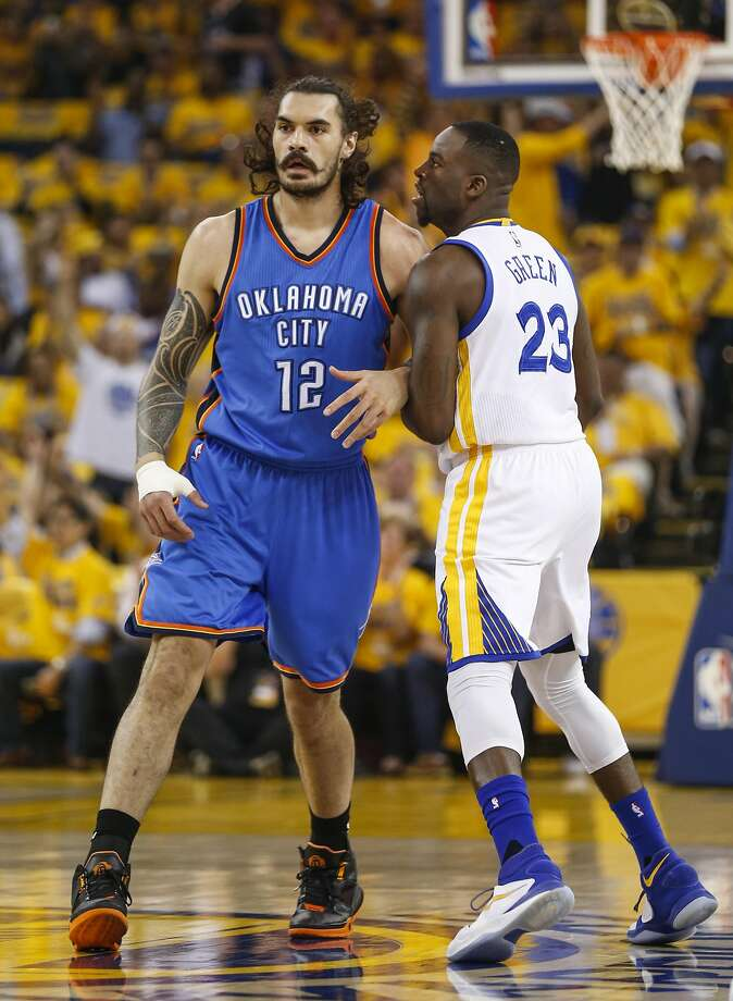 Golden State Warriors' Draymond Green runs into Oklahoma City Thunders' Steven Adams after hitting a first quarter three pointer during Game 2 of the NBA Western Conference Finals at Oracle Arena on Wednesday, May 18, 2016 in Oakland, Calif. Photo: Scott Strazzante, The Chronicle