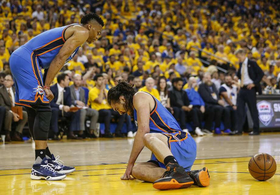Oklahoma City Thunders' Steven Adams is slow getting up in the first quarter during Game 2 of the NBA Western Conference Finals at Oracle Arena on Wednesday, May 18, 2016 in Oakland, Calif. Photo: Scott Strazzante, The Chronicle