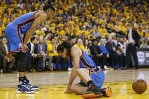 Oklahoma City Thunders� Steven Adams is slow getting up in the first quarter during Game 2 of the NBA Western Conference Finals at Oracle Arena on Wednesday, May 18, 2016 in Oakland, Calif.