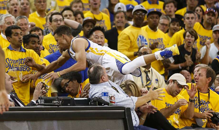golden state warriors17 stephen curry flies into the crowd in