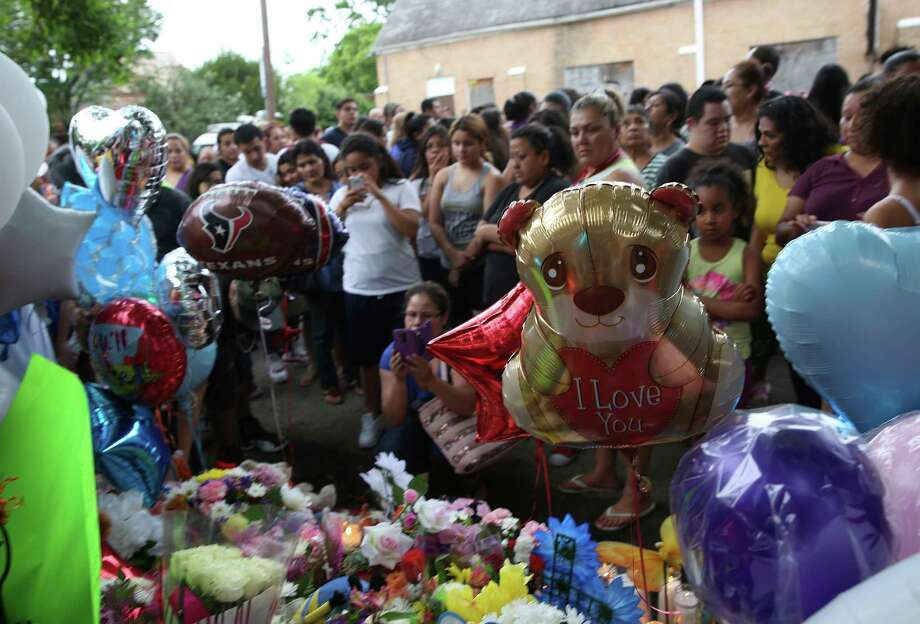 Neighbors and family members gather at a vigil on Wednesday honoring 11-year-old Josue Flores, who was stabbed to death while walking home from school on Tuesday. Photo: Elizabeth Conley, Houston Chronicle / © 2016 Houston Chronicle