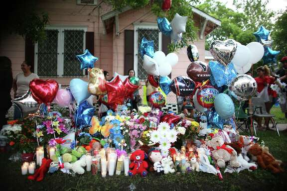 A memorial  for  11-year-old Josue Flores, who was stabbed to death while walking home Tuesday from school ,on Wednesday, May 18, 2016, in Houston.