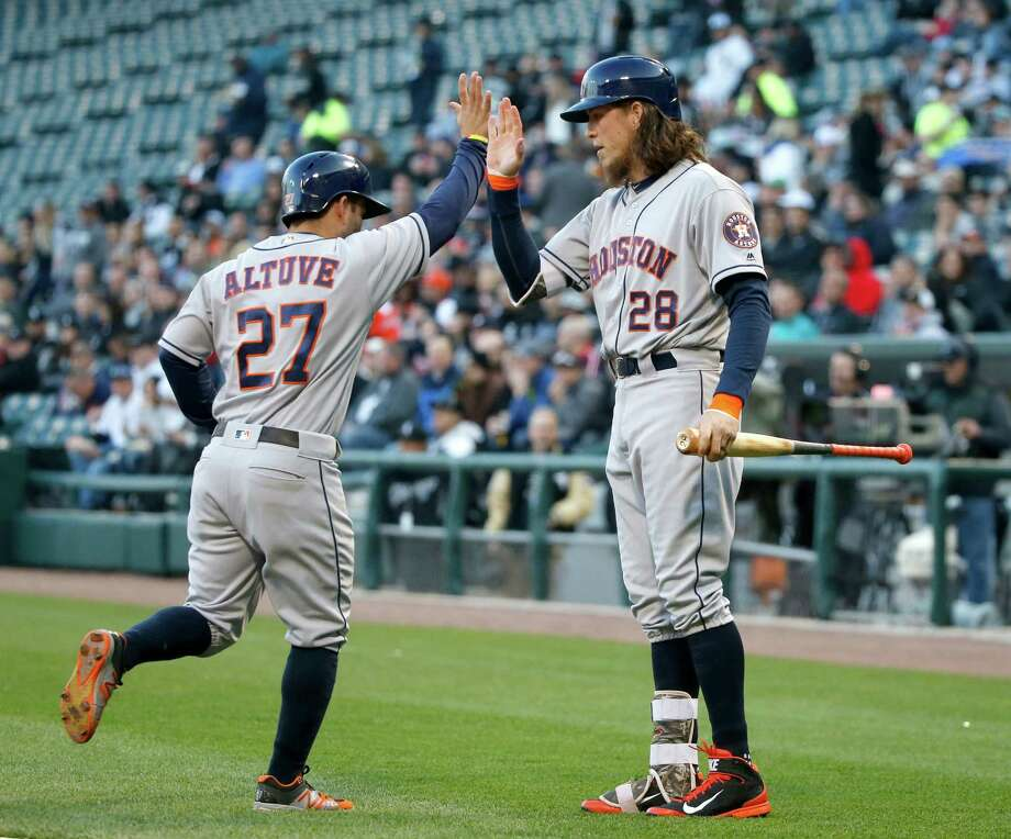 Houston Astros' Colby Rasmus (28) greets Jose Altuve at home after Altuve scored on a single by Carlos Correa during the first inning of a baseball game against the Chicago White Sox, Wednesday, May 18, 2016, in Chicago. (AP Photo/Charles Rex Arbogast) Photo: Charles Rex Arbogast, Associated Press / Copyright 2016 The Associated Press. All rights reserved. This material may not be published, broadcast, rewritten or redistribu