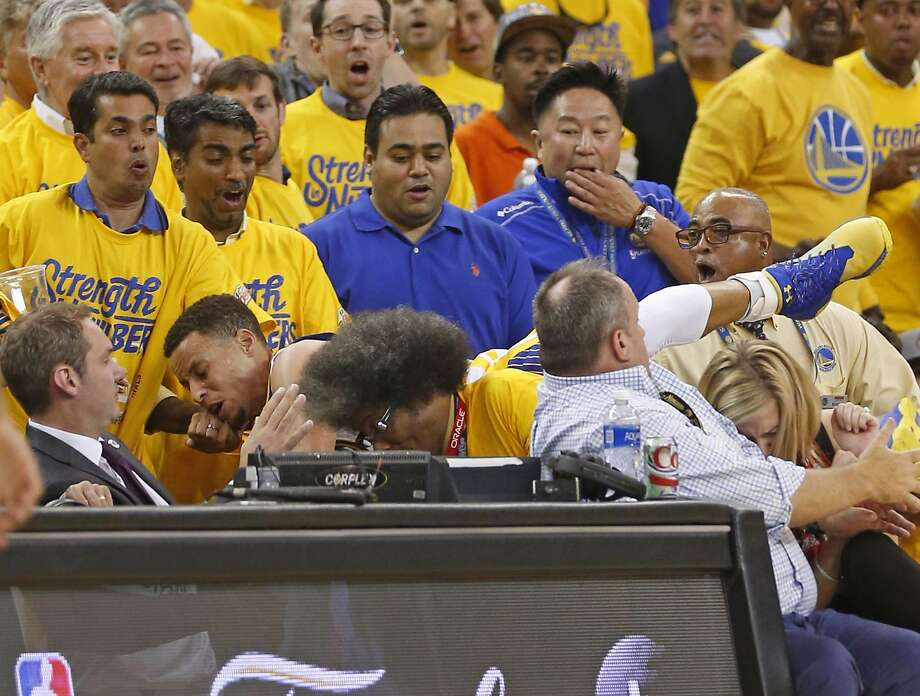 Golden State Warriors' Stephen Curry ends up in stands chasing ball in 1st quarter against Oklahoma City Thunder during Game 2 of NBA Playoffs' Western Conference Finals at Oracle Arena in Oakland, Calif., on, Calif., on Wednesday, May 18, 2016. Photo: Scott Strazzante, The Chronicle