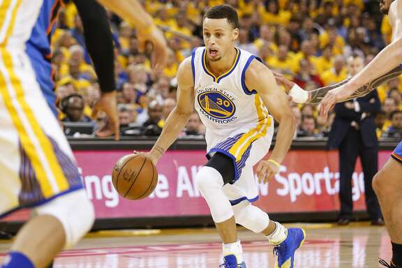 Golden State Warriors� Stephen Curry drives in the first quarter during Game 2 of the NBA Western Conference Finals at Oracle Arena on Wednesday, May 18, 2016 in Oakland, Calif.