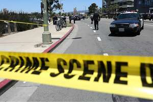 Oakland police investigate the scene of a shooting on Lakeshore Avenue in Oakland, Calif., on Friday, June 19, 2015. Three people shot five blocks from the NBA championship celebration for the Golden State Warriors in Oakland are in stable condition. Police say they received a call shortly after noon and found three male victims with gunshot wounds. (Jane Tyska/The Oakland Tribune via AP)