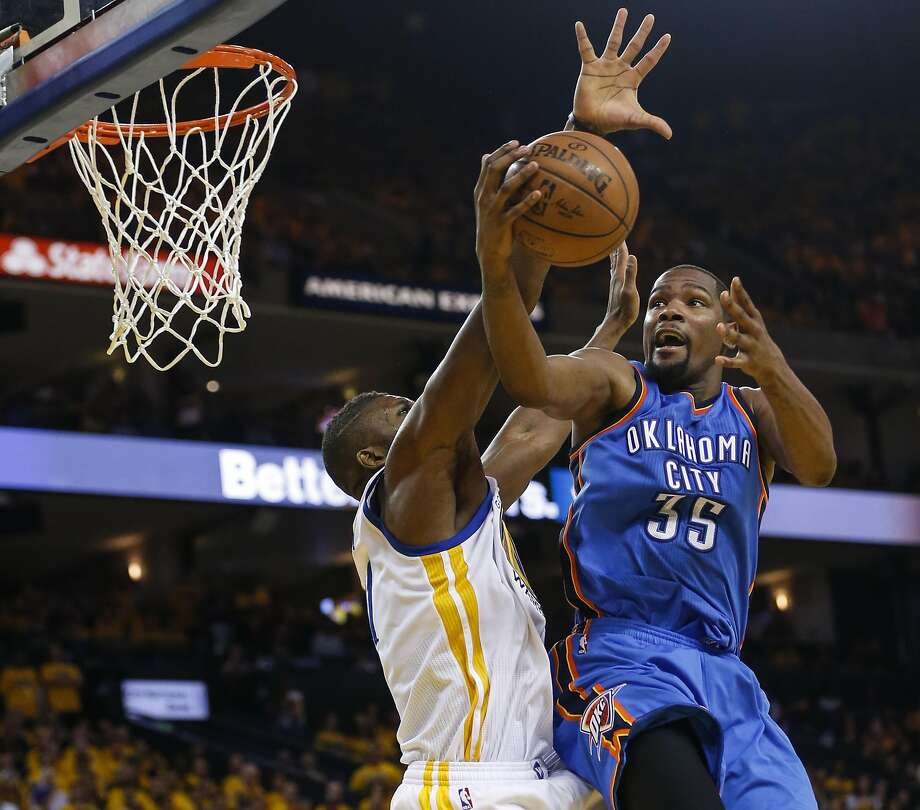 Golden State Warriors� Festus Ezeli defends against Oklahoma City Thunders� Kevin Durant in the third quarter during Game 2 of the NBA Western Conference Finals at Oracle Arena on Wednesday, May 18, 2016 in Oakland, Calif. Photo: Scott Strazzante, The Chronicle