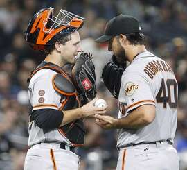 San Francisco Giants pitcher Madison Bumgarner (40) and catcher Buster Posey confer after striking out the San Diego Padres' Derek Norris in the sixth inning at Petco Park in San Diego, Calif., on Tuesday, May 17, 2016. (Hayne Palmour IV/San Diego Union-Tribune/TNS)