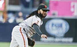 San Francisco Giants starting pitcher Johnny Cueto throws against the San Diego Padres in the first inning of a baseball game Wednesday, May 18, 2016, in San Diego.   (AP Photo/Lenny Ignelzi)