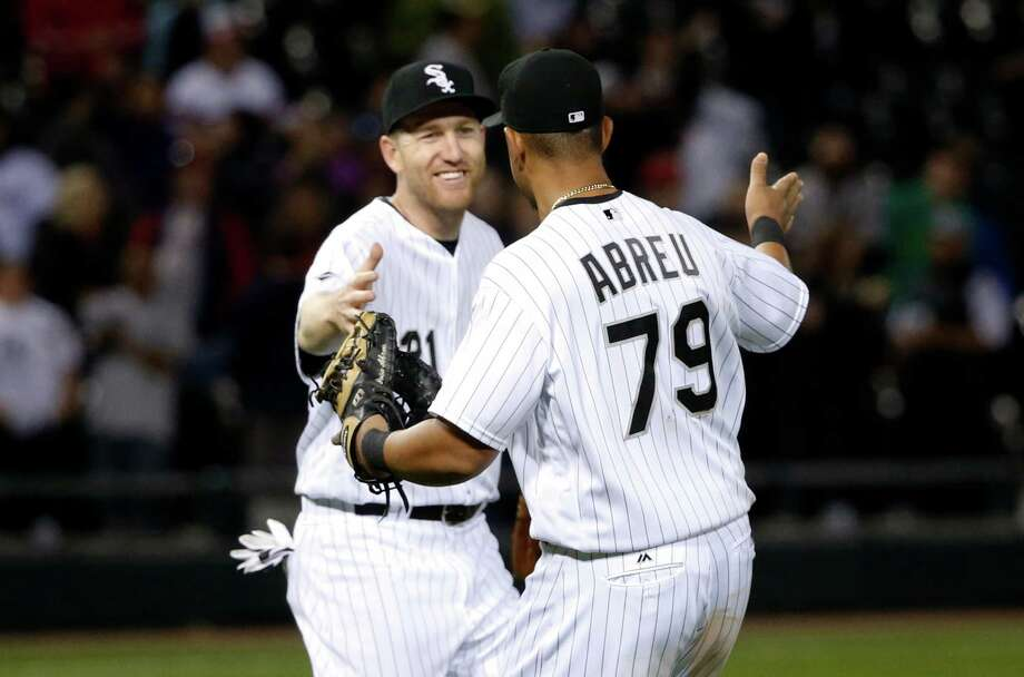 White Sox third baseman Todd Frazier, left, initiated the triple play against the Astros on Wednesday. Photo: Charles Rex Arbogast, Associated Press / Copyright 2016 The Associated Press. All rights reserved. This material may not be published, broadcast, rewritten or redistribu