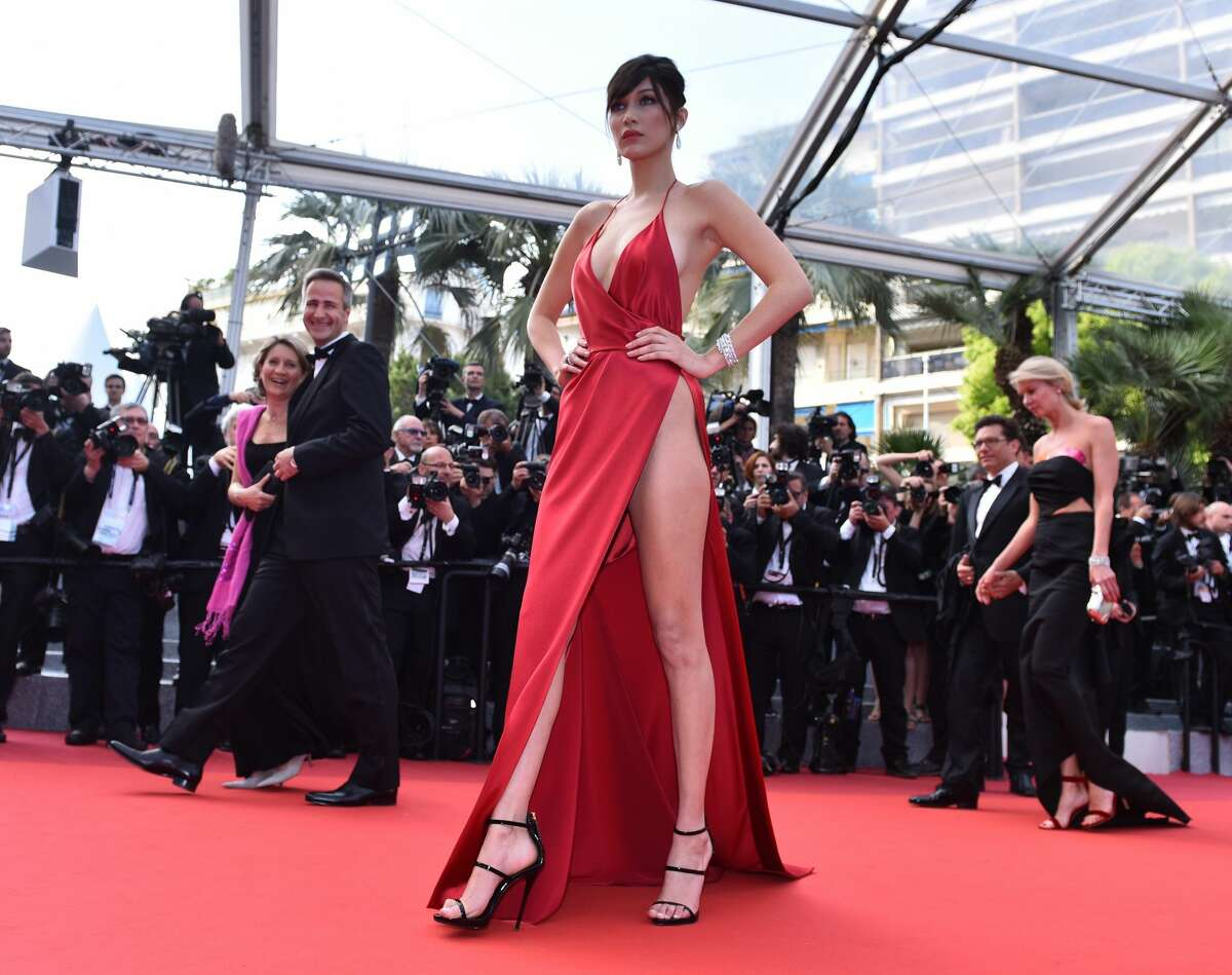 Hadid, a high-fashion model from a wealthy family, loosely draped a creation by French designer Alexandre Vauthier over her 19-year-old physique and struggled mightily to keep it from revealing what little was left to the imagination on her way into a film premiere.