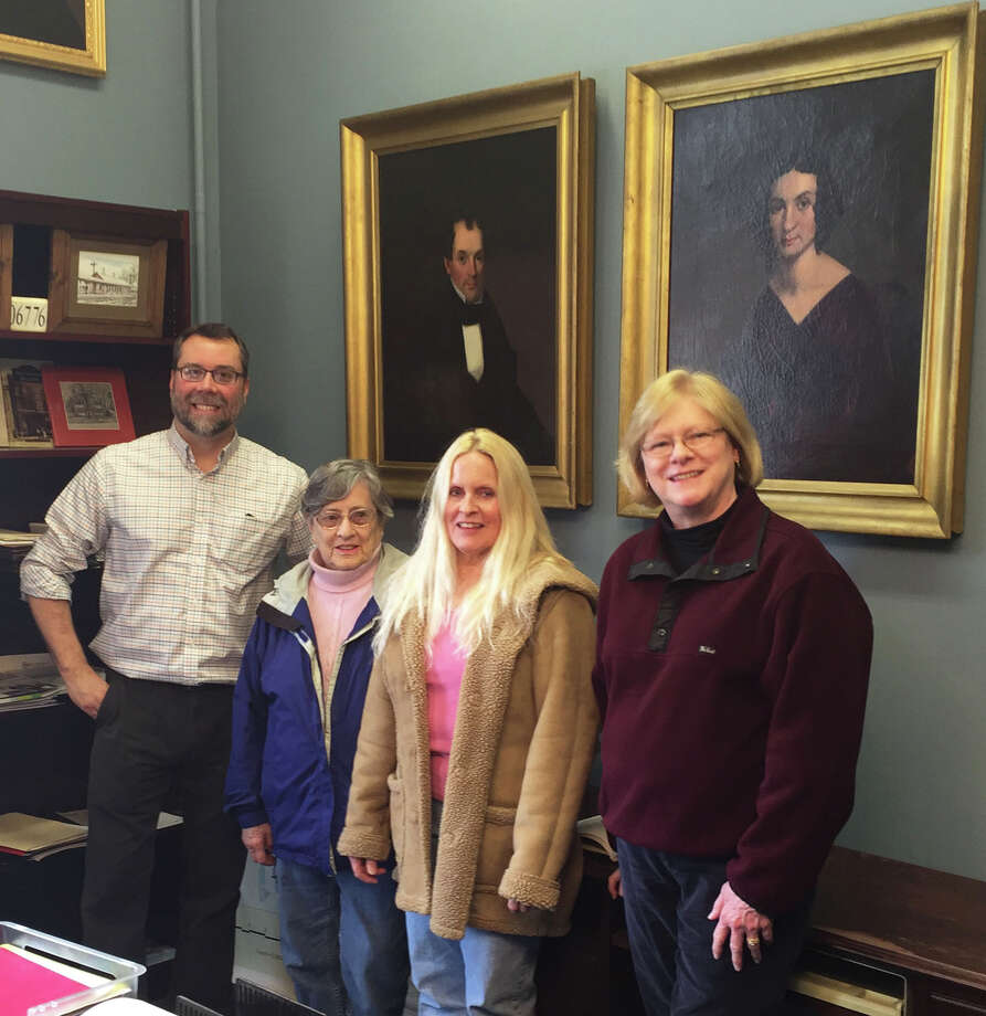 New Milford Historical Society and Museum paintings now grace the New Milford's mayor's office. A ceremony to celebrate the addition to the office was held April 6. Above, Mayor David Gronbach, left, joins, from left to right, Charlotte Bostwick and her daughter, Carol Barnhart, and her niece, Sarah Straub, all direct descendants of Solomon Edgar Bostwick and Adaline Booth Bostwick, whose portraits are now on exhibit at town hall. Photo: Courtesy Of New Milford Historical Society & Museum / The News-Times Contributed