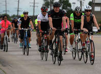 Cyclists ride down North Major Drive during the Ride of Silence on Wednesday night. The ride is an annual memorial ride for cyclists who have been killed while riding, with cyclists participating in events around the country. The ride was first held in Beaumont in memory of Kathy Grantham, who was killed while riding on State Highway 105 on Oct. 15, 2004.  Photo taken Wednesday 5/18/16 Ryan Pelham/The Enterprise