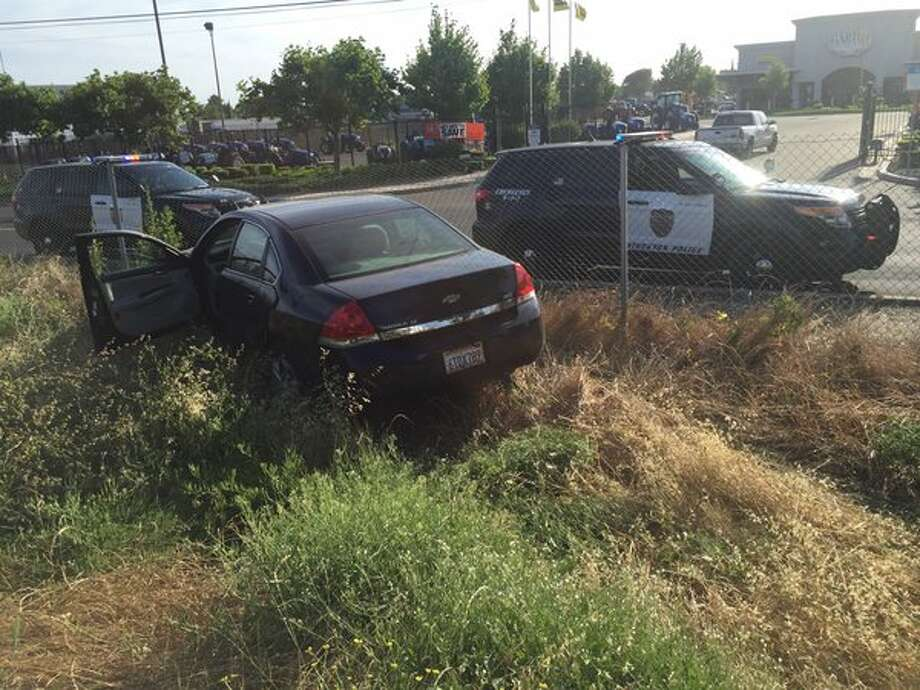 A Chevrolet Impala driven by Alex Quinones, 22, who is suspected of kidnapping his 15-year-old girlfriend in Stockton Thursday morning, was found abandoned on Interstate 5 near Stockton. Photo: Stockton Police Department / /