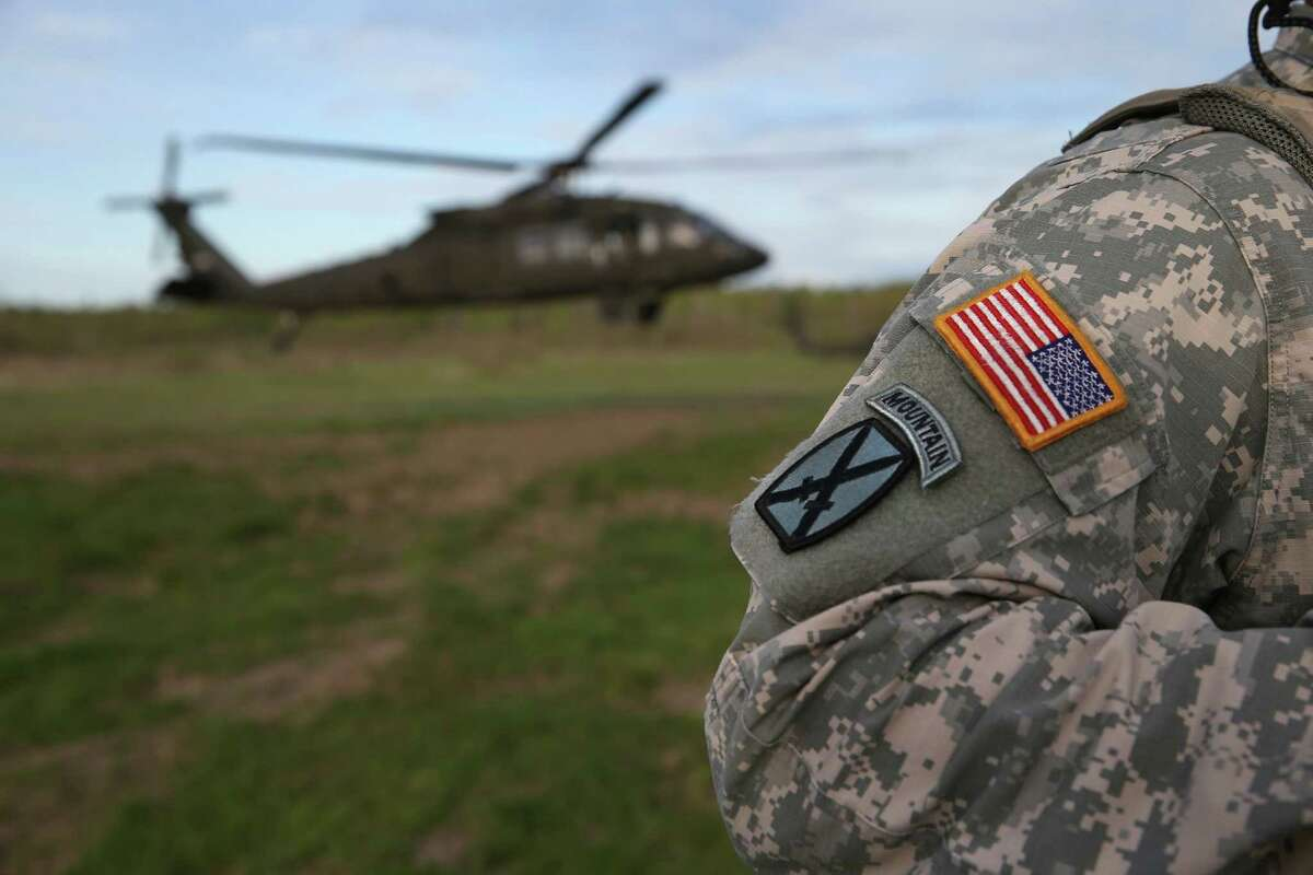 FORT DRUM, NY - MAY 18: The 10th Mountain Division soldiers prepare to board a Blackhawk helicopter while on a training mission for future deployments on May 18, 2016 at Fort Drum, New York. Although most U.S. combat forces have been withdrawn from the continuing wars in Iraq and Afghanistan, the troops are on near-constant training exercises for future conflicts. (Photo by John Moore/Getty Images)