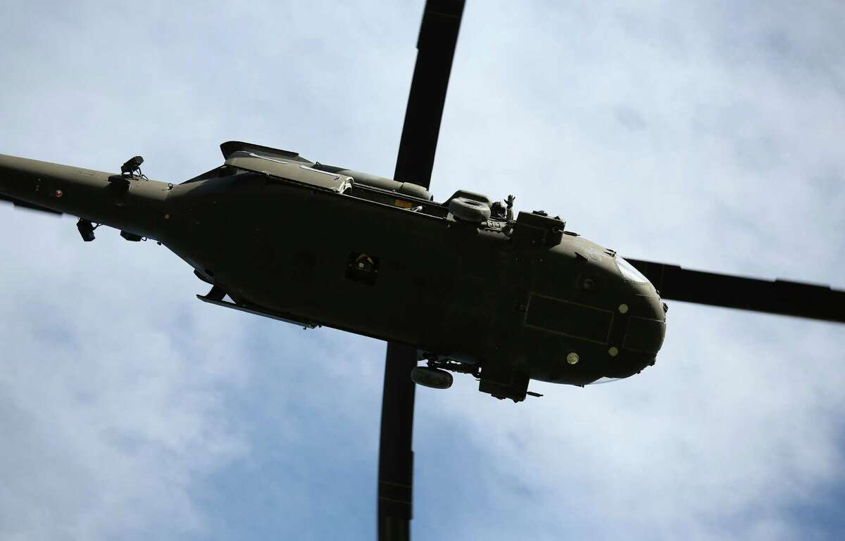FORT DRUM, NY - MAY 18: A 10th Mountain Division Blackhawk helicopter passes overhead during a training mission for future conflicts on May 18, 2016 at Fort Drum, New York. Although most U.S. combat forces have been withdrawn from the continuing wars in Iraq and Afghanistan, the troops are on near-constant training exercises for future deployments. (Photo by John Moore/Getty Images)