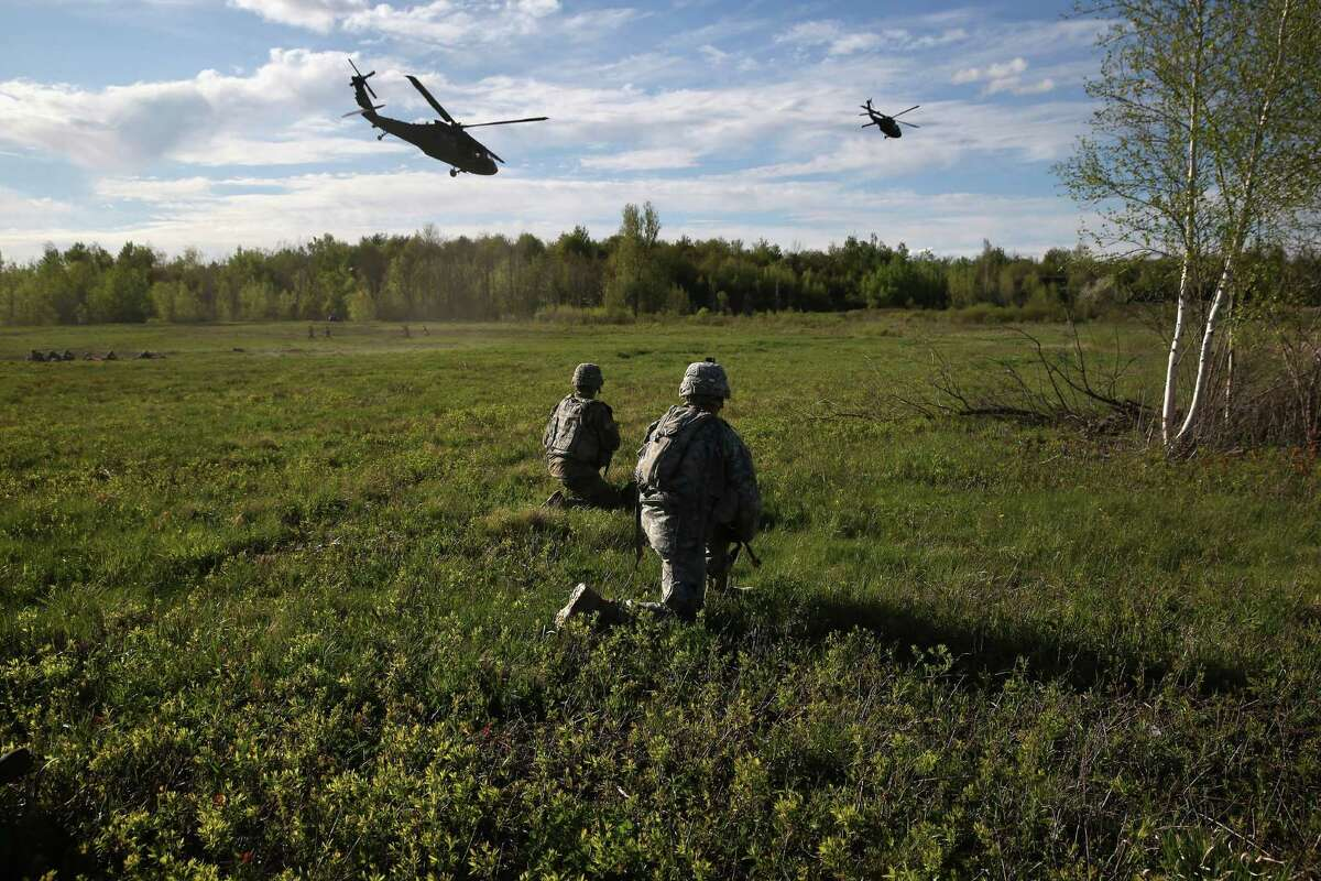 FORT DRUM, NY - MAY 18: The 10th Mountain Division soldiers stand watch as Blackhawk helicopters fly past during a training exercise for future conflicts on May 18, 2016 at Fort Drum, New York. Rep. Elise Stefanik is still pushing for a missile defense system to be built at Fort Drum. (Photo by John Moore/Getty Images)