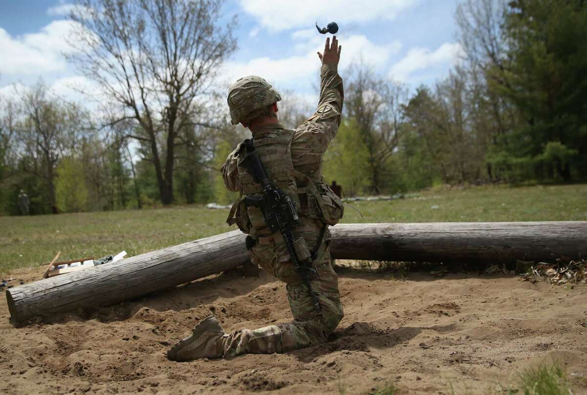 FORT DRUM, NY - MAY 18: A 10th Mountain Division soldier hurls an unarmed grenade during a training exercise for future conflicts on May 18, 2016 at Fort Drum, New York. Members of Bravo Company, 41st Engineer Battalion threw both live and dummy grenades during the exercise. Although most U.S. combat forces have been withdrawn from the continuing wars in Iraq and Afghanistan, the troops are on near-constant training missions for future deployments. (Photo by John Moore/Getty Images)