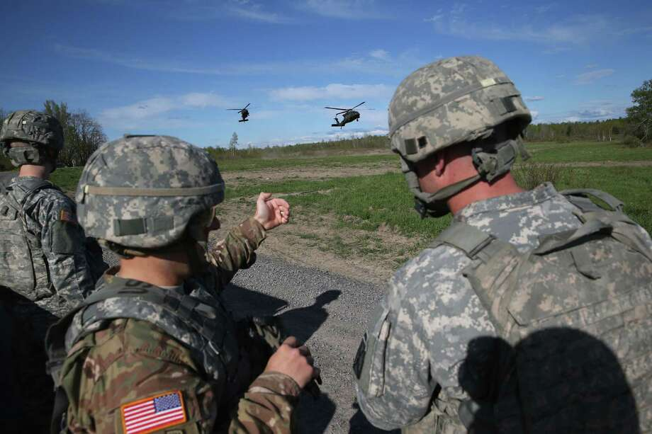 FORT DRUM, NY - MAY 18:  The 10th Mountain Division stand by as Blackhawk helicopters arrive for a training mission for future conflicts on May 18, 2016 at Fort Drum, New York. Although most U.S. combat forces have been withdrawn from the continuing wars in Iraq and Afghanistan, the troops are on near-constant training exercises for future deployments.  (Photo by John Moore/Getty Images) Photo: John Moore / 2016 Getty Images