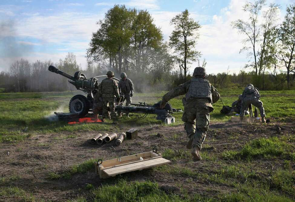FORT DRUM, NY - MAY 18: The 10th Mountain Division artillerymen fire a 105mm Howitzer during a training mission for future conflicts on May 18, 2016 at Fort Drum, New York. Members of Alpha Battery 3-6 Field Artillery staged an aerial assault and fired the guns, before flying them back out. Although most U.S. combat forces have been withdrawn from the continuing wars in Iraq and Afghanistan, the troops are on near-constant training exercises for future deployments. (Photo by John Moore/Getty Images)