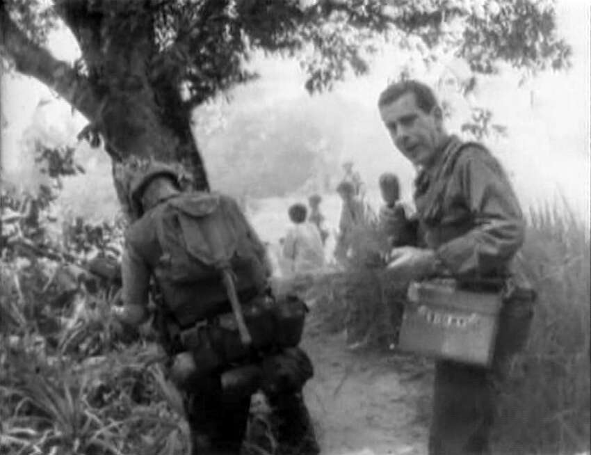 American news broadcaster Morley Safer, correspondent for CBS News, as Safer reports on the systematic burning of South Vietnamese villages by US Marines during the Vietnam War, Cam Ne, Vietnam, 1965. The broadcast showed US Marines igniting huts with Zippo lighters. Photo is a screen grab. (Photo by CBS via Getty Images)