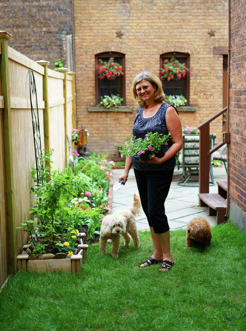 Karin Krasevac-Lenz in her hidden downtown Troy garden.