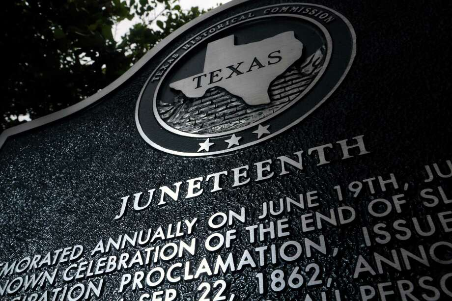 The first historical marker authorized by the Texas Historical Commission to commemorate Juneteenth, the issuance of the proclamation June 19, 1865, ending slavery in Texas, was formally dedicated in 2014 in downtown Galveston. Photo: Billy Smith II, Staff / © 2015 Houston Chronicle