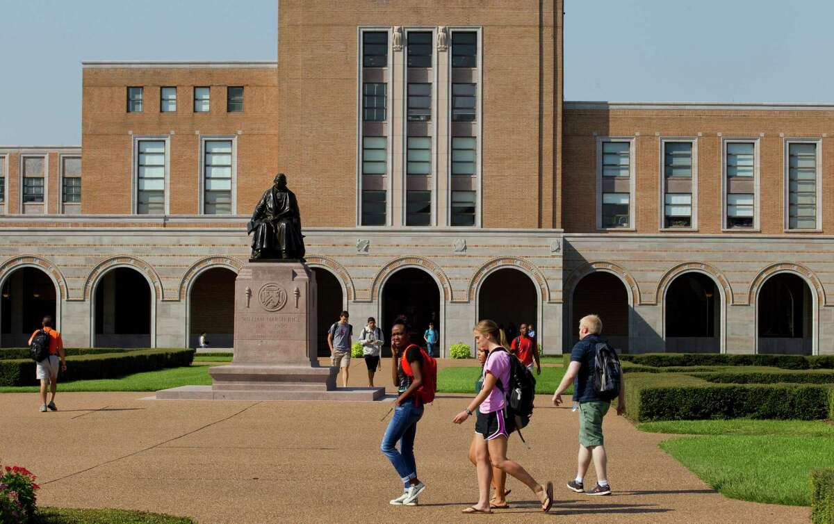 Students walk past the statue of Rice University founder William Marsh Rice between classes Tuesday, Oct. 2, 2012, in Houston. Rice celebrates its 100th anniversary this year. ( Brett Coomer / Houston Chronicle )