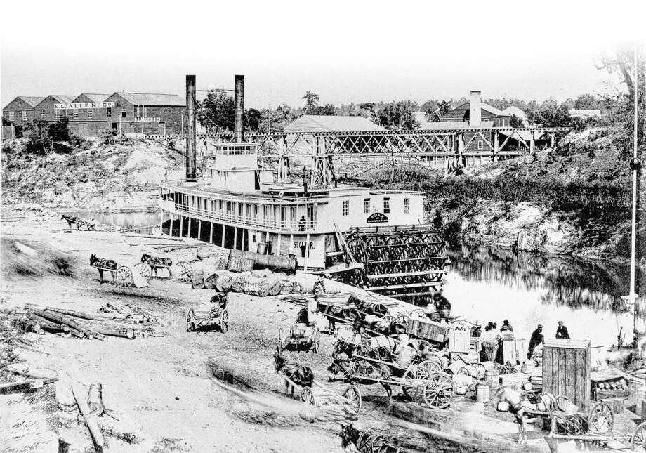 A paddlewheel boat being loaded with cotton at Allen's Landing, present-day downtown Houston, in 1868. Early European settlers to the region found a swampy wilderness that had to be drained before it could be developed. Photo: Ed Stewart Photography / handout