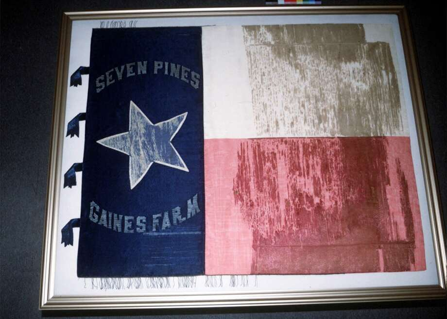 This flag, which was used by the First Texas Infantry, Hood's Brigade, during the Civil War, was one of nine historic flags from the Texas Revolution and Civil War restored for display in the state archives.  John Bell Hood  shot up the ranks in the Confederate Army after distinguishing himself in several major battles. He briefly led a brigade in Robert E. Lee's Army of Northern Virginia that came to take on his name — Hood's Brigade — which included the greatest concentration of Texas troops who fought in the Eastern Theater. Photo: HO / TEXAS HISTORICAL COMMISSION