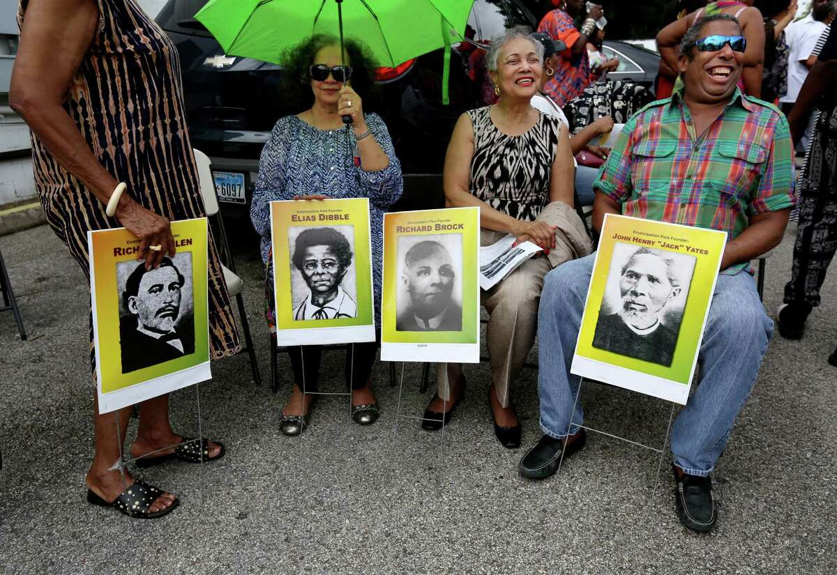 """Left to right, Pauline Kelly, Michelle Barnes, Jacqueline Bostic, and Kirksten Bostic, shown with images of the founding fathers of Emancipation Park, Richard Allen, Elias Dibble, Richard Brock and Jack Yates, at a Juneteenth prayer vigil and drum call march around Emancipation Park to bless the parké¢Ã©""""é´s new construction and anticipated 2016 rebirth Friday, June 19, 2015, in Houston. At each corner ministers from twelve churches will pray and pay tribute to one of the park's 4 founders: Rev. Jack Yates, Richard Brock, Richard Allen and Rev. Elias Dibble. Juneteenth is the oldest nationally celebrated commemoration of the ending of slavery in the United States. ( Gary Coronado / Houston Chronicle )"""