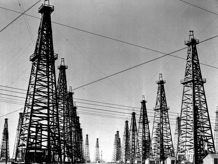 This photo shows a street of oil derricks at Spindletop, three miles from Beaumont, Texas, on Dec. 23, 1941. The modern petroleum industry was born on January 10, 1901 when the Lucas Gusher, Spindletop No. 1, made the world oil-conscious and started exploration on a grand scale. (AP Photo)
