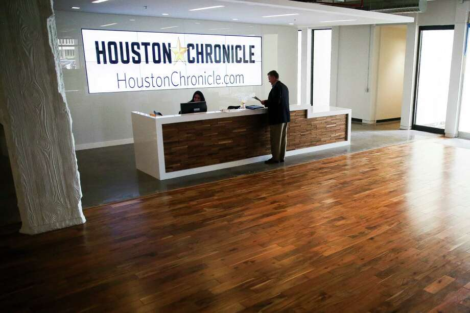 Muller Martini National Sales Director, mailroom Systems Gary Owen grabs a paper at the front desk of the new Houston Chronicle building at 4747 Southwest Freeway Wednesday, April 20, 2016 in Houston as he waits to meet with an employee. The paper celebrates its 115th anniversary this year. ( Michael Ciaglo / Houston Chronicle ) Photo: Michael Ciaglo, Staff / © 2016  Houston Chronicle