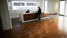 Muller Martini National Sales Director, mailroom Systems Gary Owen grabs a paper at the front desk of the new Houston Chronicle building at 4747 Southwest Freeway Wednesday, April 20, 2016 in Houston as he waits to meet with an employee. The paper celebrates its 115th anniversary this year. ( Michael Ciaglo / Houston Chronicle )