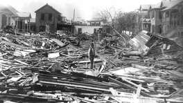 A man walks through the debris in Galveston in September 1900 after a surprise hurricane devastated the then prospering city. More than 6,000 people died and 10,000 were left homeless in what remains the worst natural disaster in U.S. history. (AP Photo, Rosenberg Library)