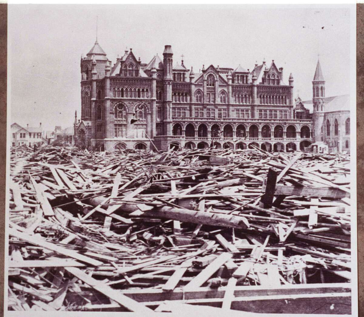 The Ursuline Academy shoqn surrounded with debris after the 1900 storm. The Ursline nuns are credited with saving over 1,500 people.