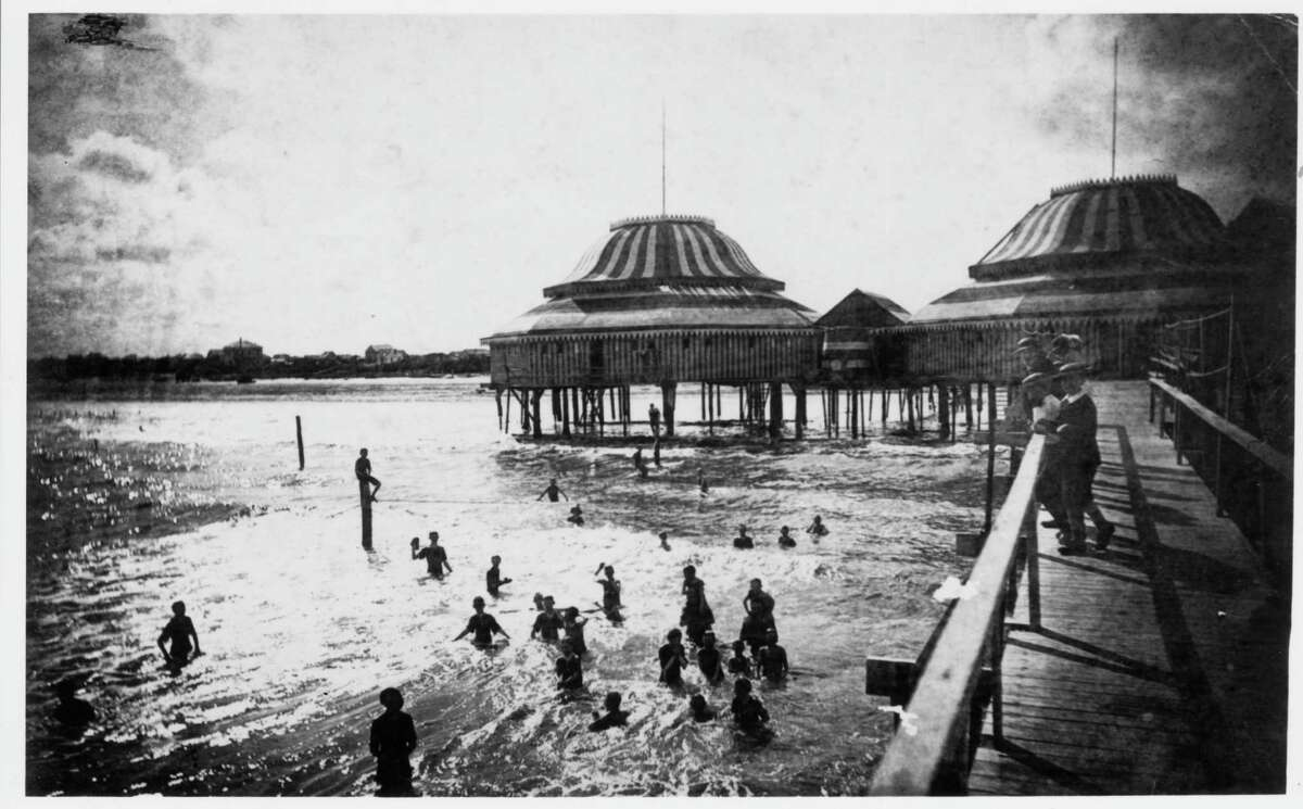 1900: Galvestonians enjoy the beach and surf at The Pagoda, described as 'a building extending out into the sea on a piling, with a long walk.' Islanders watched the sea from the walkway for the last time on Sept. 8, 1900 when a hurricane of 100-plus miles per hour and towering tidal waves destroyed or damaged most of the city, killing thousands. The Pagoda was not rebuilt.