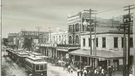 The photograph, made in the 1890s, depicts the heart of the business district near the intersection of Main and Preston.