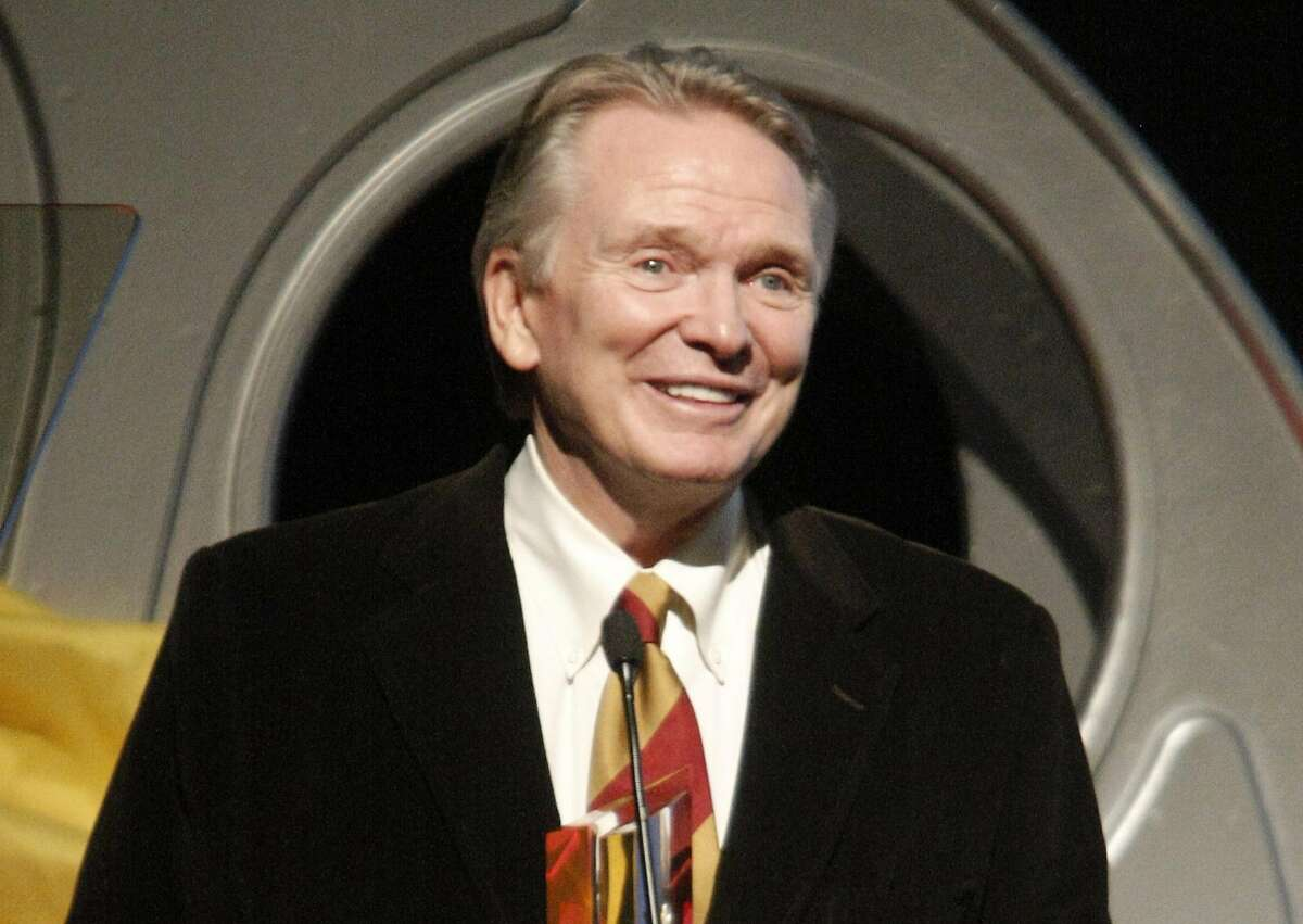 FILE - In this Oct. 12, 2008 file photo, fashion designer Bob Mackie receives an award at the Hollywood Life 5th Annual Hollywood Style Awards in Los Angeles. Mackie, who is famous for his sparkling, imaginative costume designs, will receive the Designer of Excellence Award by the Chicago History Museum's Costume Council on Tuesday, April 19, 2016. (AP Photo/Dan Steinberg, File)