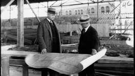 Jesse H. Jones, left, talks with architect Alfred C. Finn in 1928 at the old convention center construction site. Jones was instrumental in transforming downtown Houston into a premier business district.